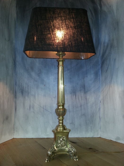 Antique brass lamp (75 cm) with religious images on lion paws, ca. 1920, Belgium