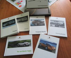 7 Porsche books and brochures