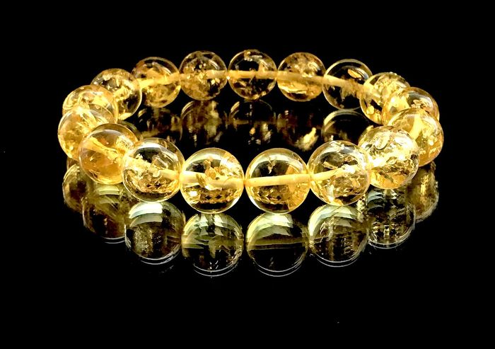 Bracelet  with natural Baltic amber beads 12.6 mm in diameter