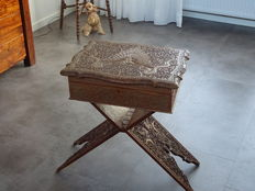 Sewing chest in fine wood carvings on carved wood folding table