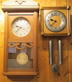 A regulator and a wall clock