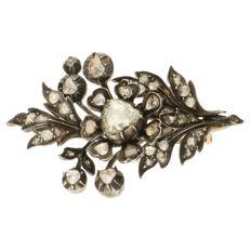 Yellow gold and silver branch-shaped brooch, set with 43 rose cut diamonds, approx. 0.76 ct in total