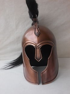 "Beautiful Greek helmet tesame model as used in the movie ""300"" and made with a bronzed steel head measurements: h 51 x 34 x 23 weight gr. 2400"