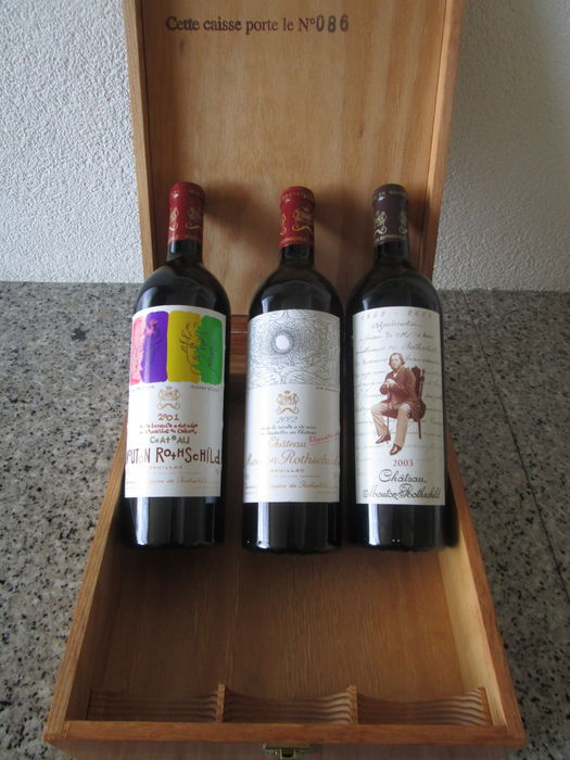 2001, 2002 & 2003 Mouton Rotschild, one of each (0,75) in numbered wooden presentation box