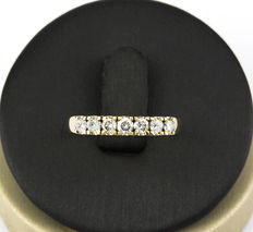 Yellow gold ring set with seven brilliant cut diamonds