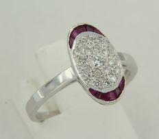 14kt White gold ring with ruby and brilliant cut diamonds.