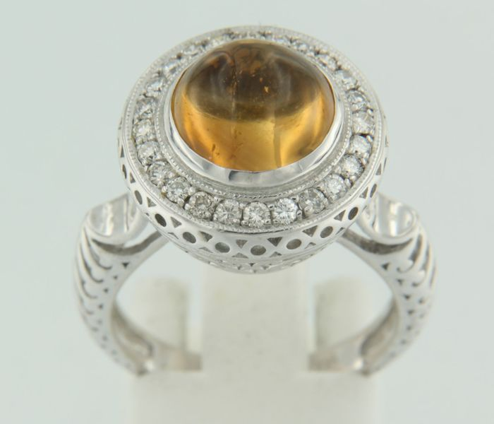 White gold ring with brilliant cut diamond and round cabochon cut citrine