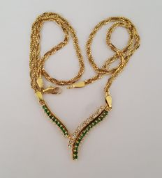 Double necklace in 18 kt gold with diamonds and emeralds