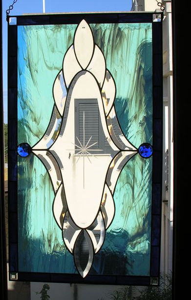 One Big beautiful stained glass in Tiffany technique created some 40 years ago