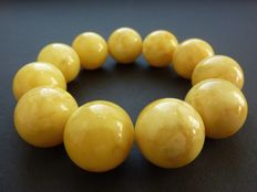 Baltic amber bracelet, opaque milk, honey colour