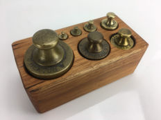Seven calibrated weights in a wooden block - Dutch - ca. 1900