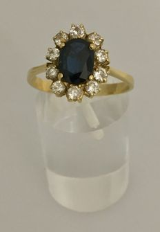 Ring with 1.50 ct central sapphire surrounded by 0.80 ct diamonds.
