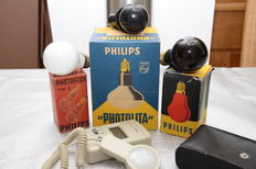Various photographic lamps, both for darkroom as well as studio, and lux meter.
