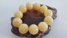 Amber bracelet white yellow milky color