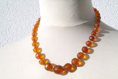 An amber necklace in faceted cuts with a twisting clasp