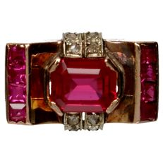 Yellow gold ring set with a synthetic ruby and 8 rose cut diamonds of approx. 0.005 ct each.