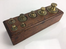 Seven calibrated weights in a wooden block - Holland - early 20th century