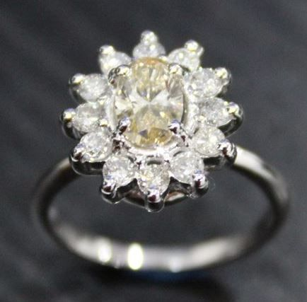 Gold ring with fancy yellow 0.90 ct. solitaire diamond ring made of 14 kt hallmarked white gold