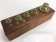 Twelve calibrated weights in a wooden block - Holland - early 20th century