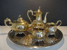 Four pieced silver plated tea set on silver plated tray