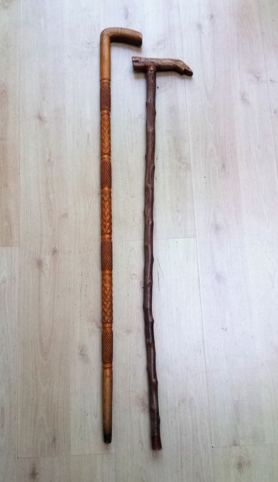 Two carved folk art walking sticks - Europe - early 20th century