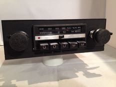 Classic car radio from 1970s with Opel front