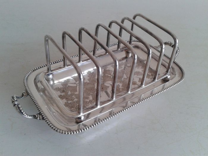 Beautiful silver plated, engraved English toast rack with pearl rim, ca 1920