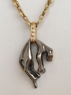 18 kt yellow gold necklace with a panther pendant, set with approx. 0.12 ct of diamonds, Wesselton/VVS.