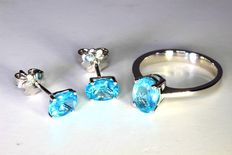 Set of 18 kt white gold ear studs and ring