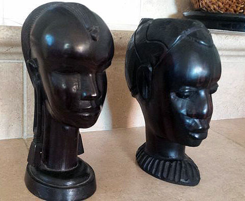 Two busts of woman in ebony-Warri (Nigeria) made in the 60s and Kenya made in the 80s