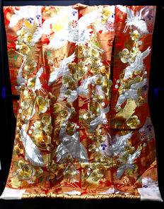 A special uchikale bridal kimono.surrounded by classic japanese designs - jpan - approx. 1960-1980.