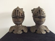2 bronze hands warmers in the shape of a Knight.