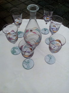 Six unique wine glasses with matching decanter