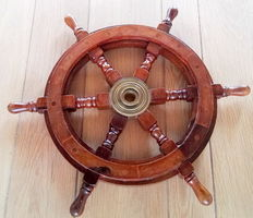 A wooden steering wheel (helm) from a boat