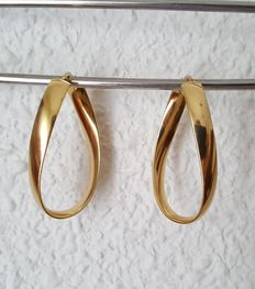 Large wavy earrings, in 18 kt gold.