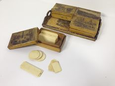Tray with four boxes of polychrome ivory card game counting chips - Germany - early 1800s