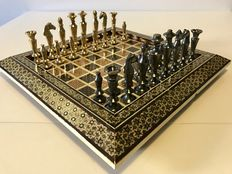 Bronze Arabian chess set with a chessboard of gold, bone and wood