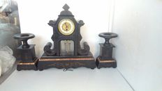 Large pendulum clock in black marble, with two columns – approx. 1900