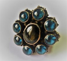 Solid silver ring set with blue quartz and a starry garnet