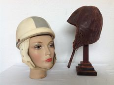 Brown leather drivers hat and old motorcycle helmet
