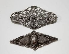 Two antique silver brooches