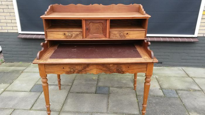 A late Biedermeier walnut and beech wood desk with mounting - probably The Netherlands - 1860-1890