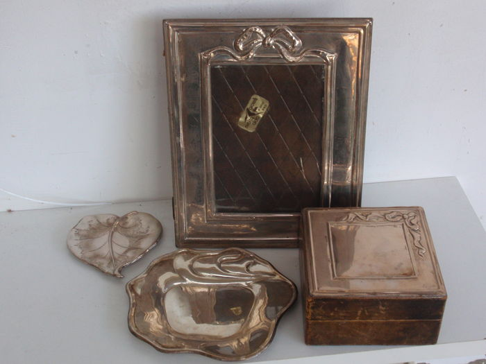 A collection of a silver picture frame, jewel box, and two serving trays, Italy, approximately 1960