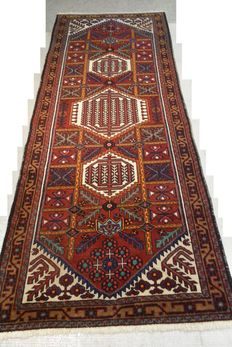 Absolute eye-catcher! Elegant hand knotted antique Persian rug 300 x 114 cm Middle of the 20th century