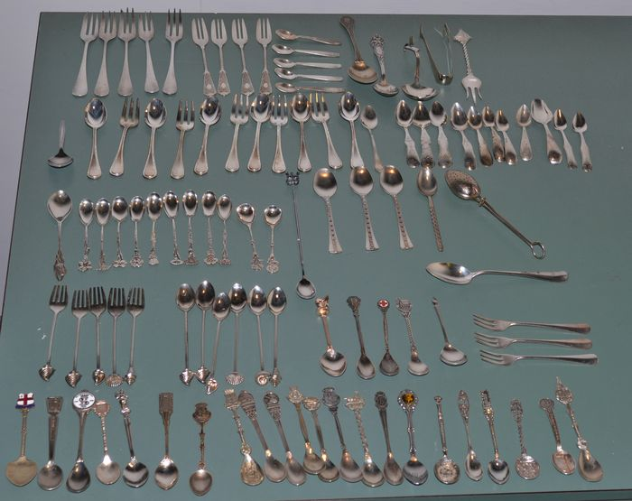 Lot with 100 silver plated forks and spoons and sugar tongs - 20th century