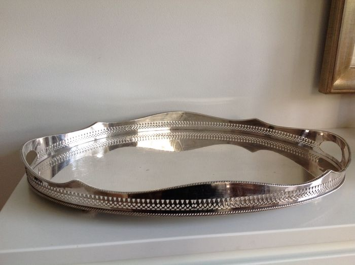 Very large silver plated oval serving tray with gallery rim and internal handles