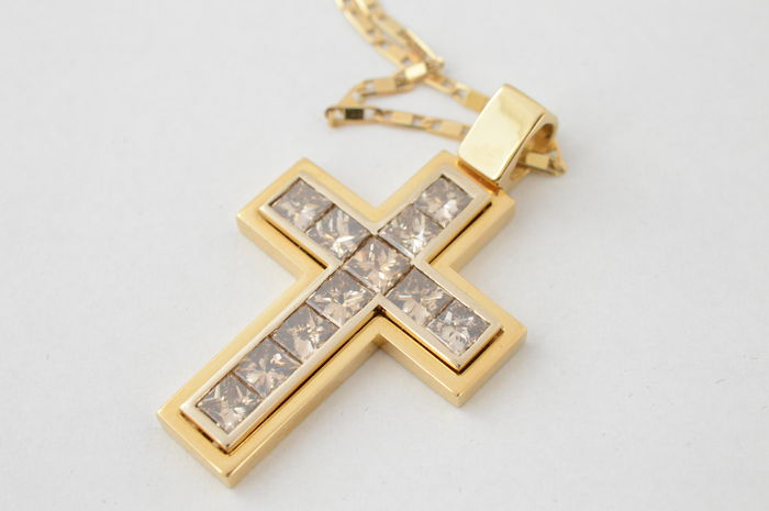 Large, gold cross set with eleven  princess cut diamonds, 5.50 carat in total.