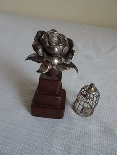 Two silver miniatures: birds cage with bird and flower on stand, Netherlands