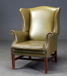 A green leather wing armchair, second half of 20th century