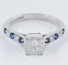 1.48 ct. White Gold Solitaire Diamond ring with Princess and round diamonds of 1.18 ct and Blue sapphire of 0.30 ct.